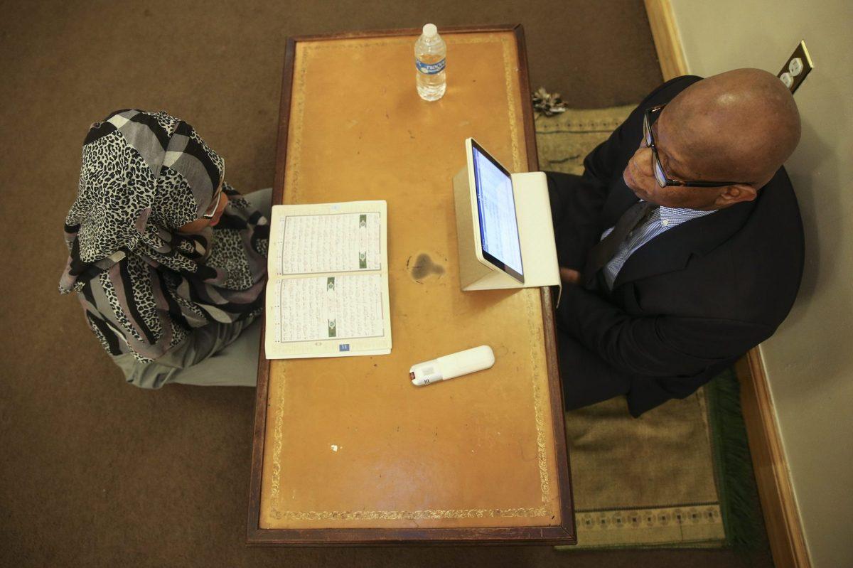 Imam Anas Muhaimin instructs student Chevonne Byas at the Quba Institute in West Philadelphia.
