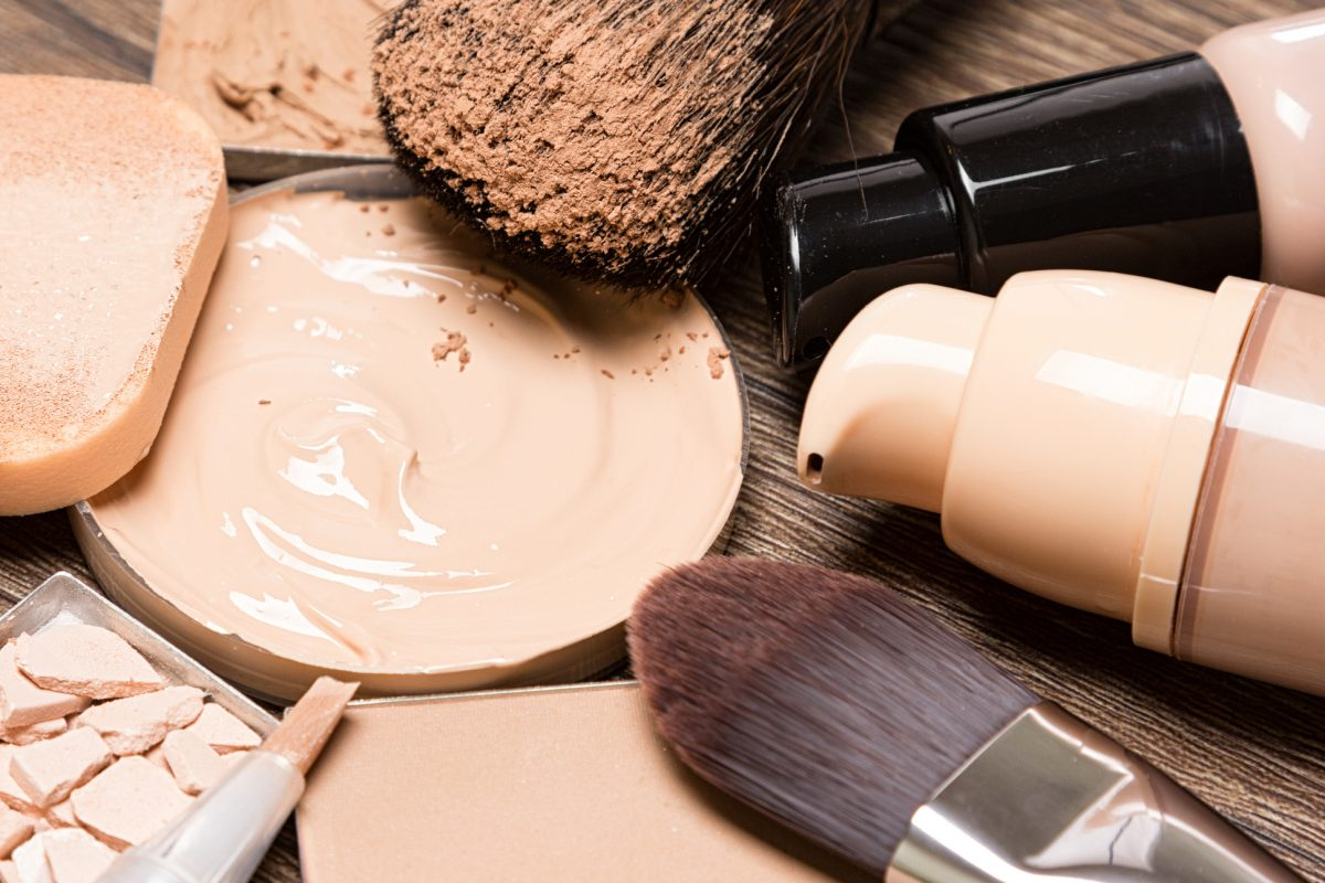 Basic makeup products for flawless complexion: foundation, concealer, powder, cosmetic sponge, professional makeup brushes.
