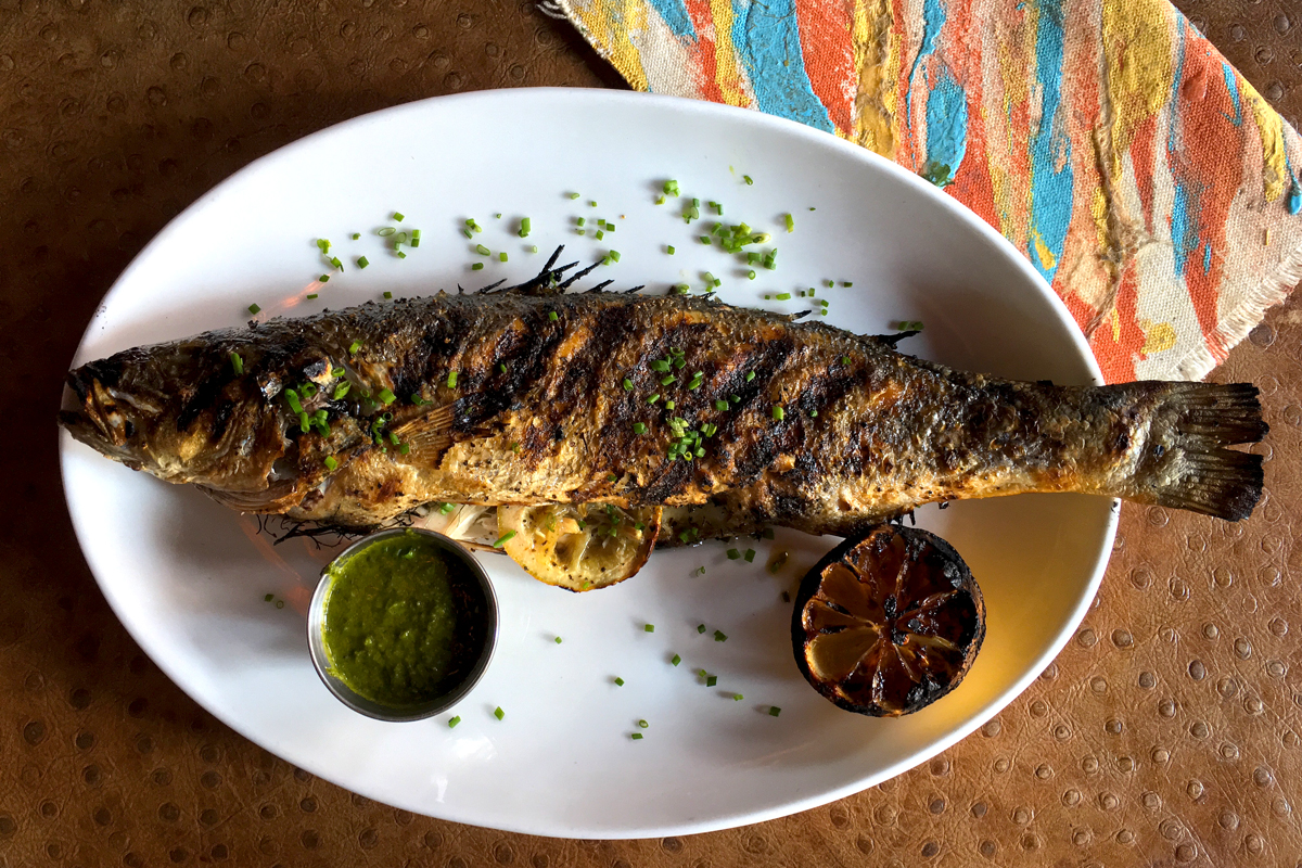 Whole branzino with chimichurri at Pinefish, 12th and Pine Streets.
