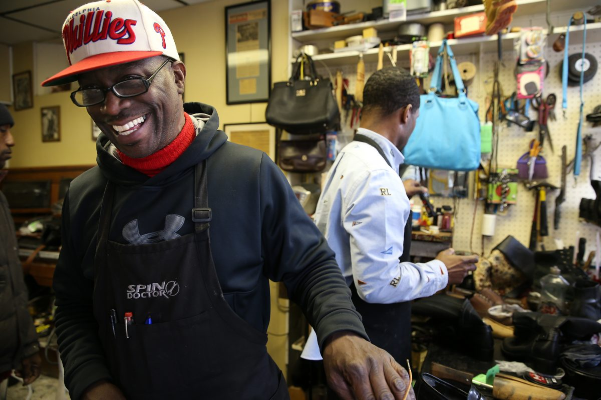 Jerry Burrell, left, laughs as he and Terrence Banks, right, repair shoes at Cliff's Shoe Shine on S. 40th Street in Philadelphia, PA on February 14, 2018. It has been a family run business for three generations.