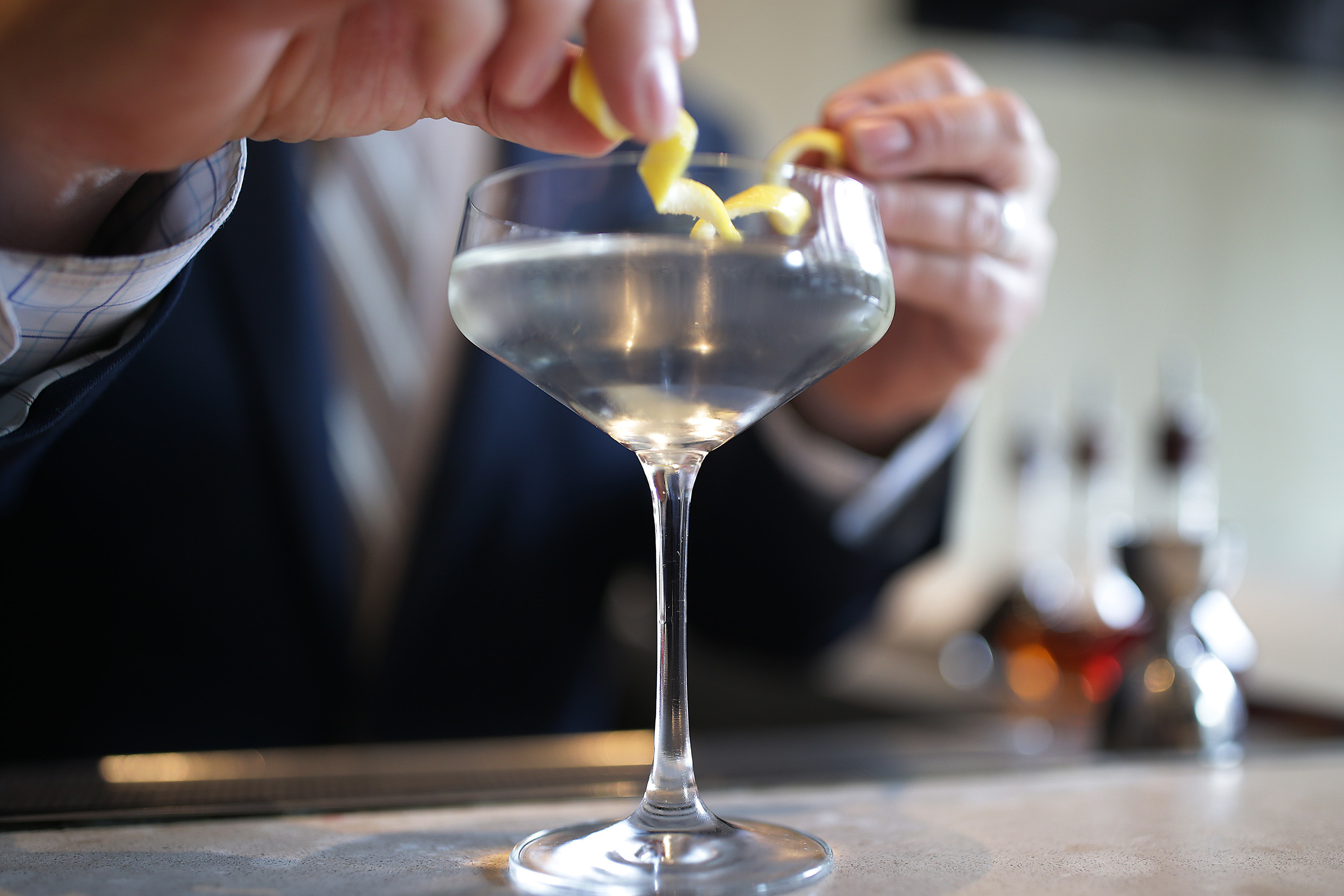 Beverage manager JB Bernstein adds a twist of lemon as he makes a classic martini at Vernick.