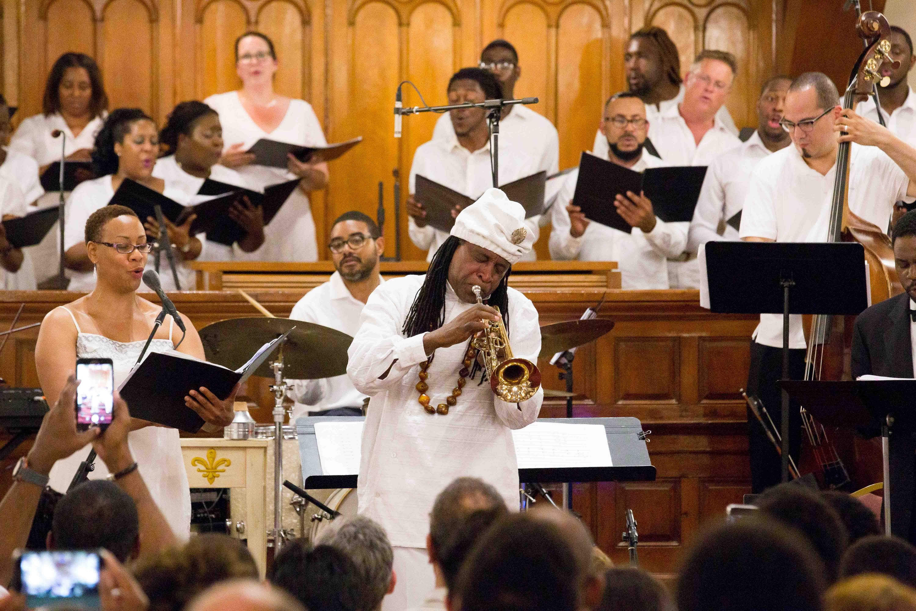 Janice Chandler, Eteme Soprano, left, and Philadelphia Orchestra Music Alive Composer-in-Residence Hannibal Lokumbe, center, perform the world premiere of Crucifixion Resurrection: Nine Souls a Traveling, at the Mother Bethel African Methodist Epicopal Church, Saturday, June 17, 2017.