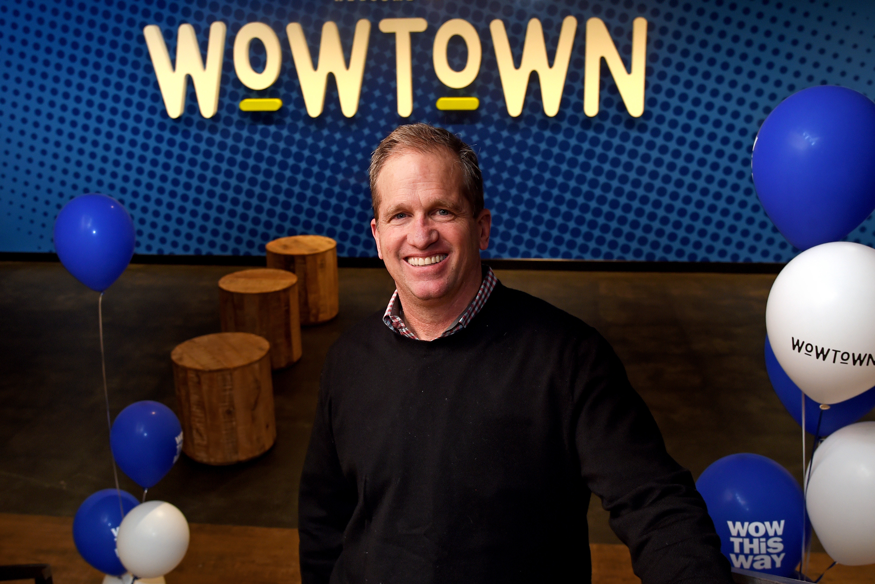 "Five Below CEO Joel Anderson poses in the entryway in the new corporate headquarters - dubbed ""WowTown"" - of his Philadelphia-based company, in the former Lit Brothers building."