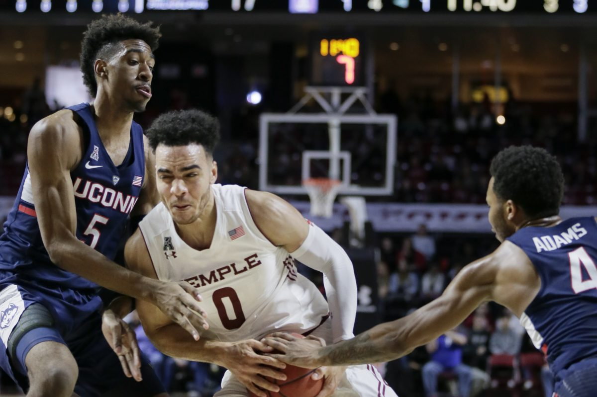 Temple´s Obi Enechionyia splitting UConn´s Isaiah Whaley and Jalen Adams (4) as he drives to the basket on Jan. 28.