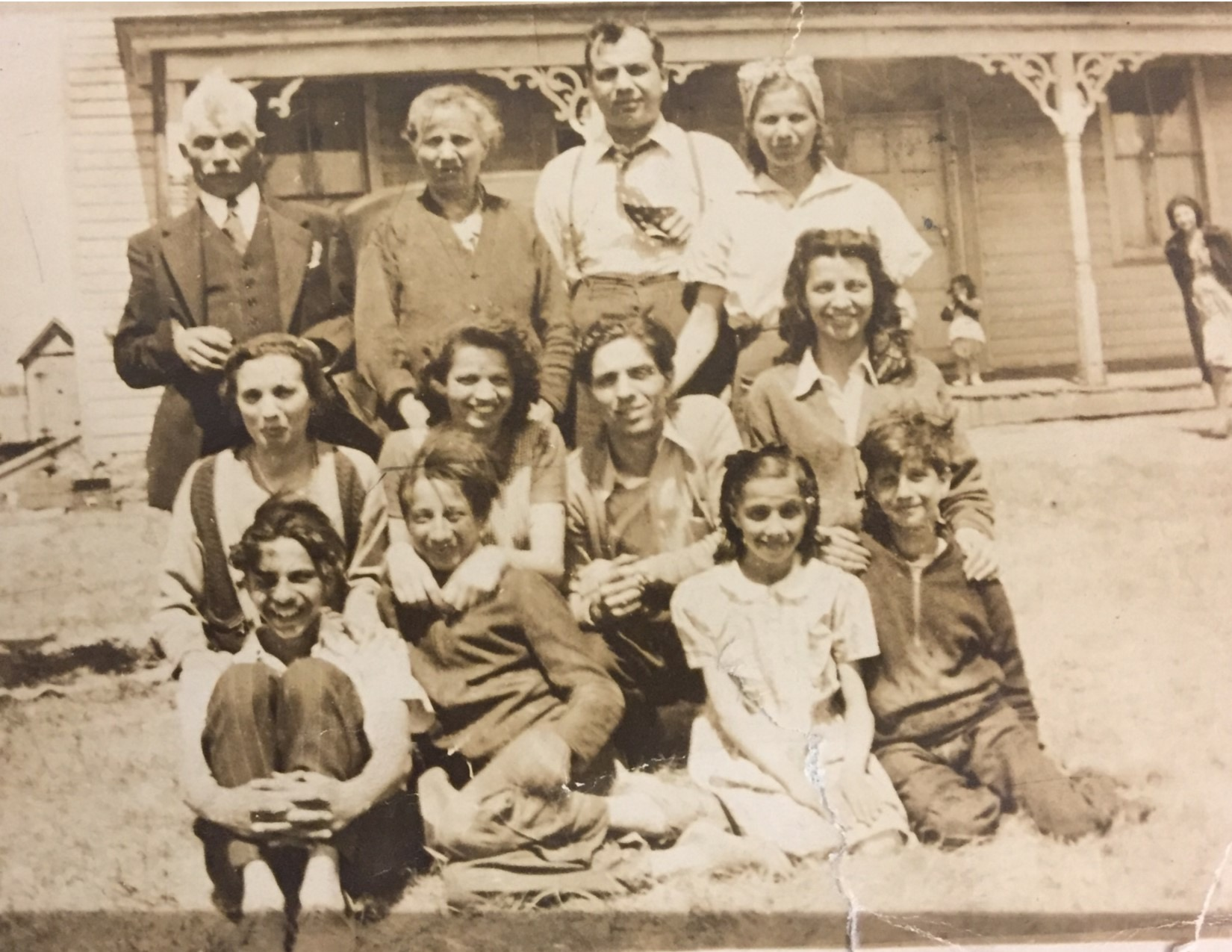 Antonette Cammarata (2nd row, far right) grew up with 11 siblings in a two-room apartment in South Philadelphia. In the summer, the family would work on a New Jersey farm, picking vegetables and sleeping in a chicken coop.