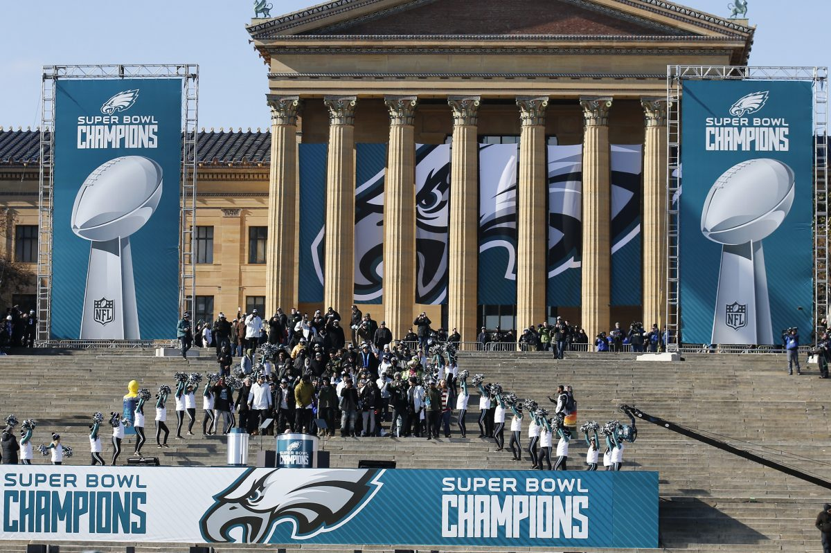 Member of the Eagles march down the steps of the Philadelphia Museum of Art during the Super Bowl LII victory celebration on Thursday, February 8, 2018. YONG KIM / Staff Photographer