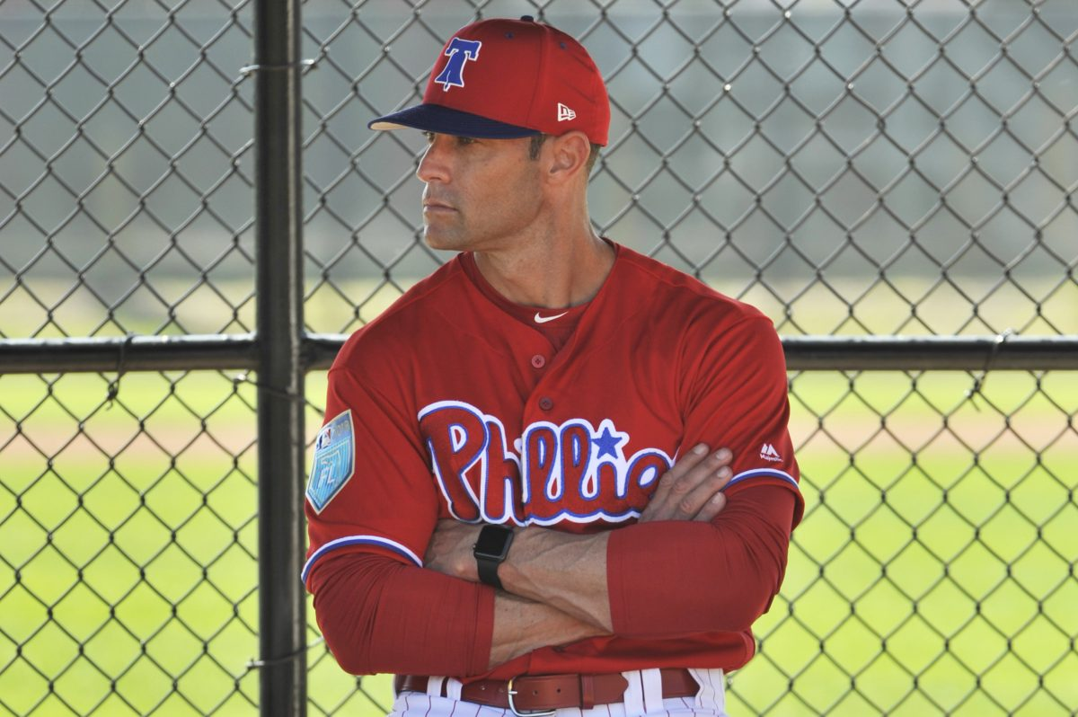 Phillies manager Gabe Kapler watches pitchers in the bullpen during workouts at the Phillies spring training complex on Thursday in Clearwater, Fla.