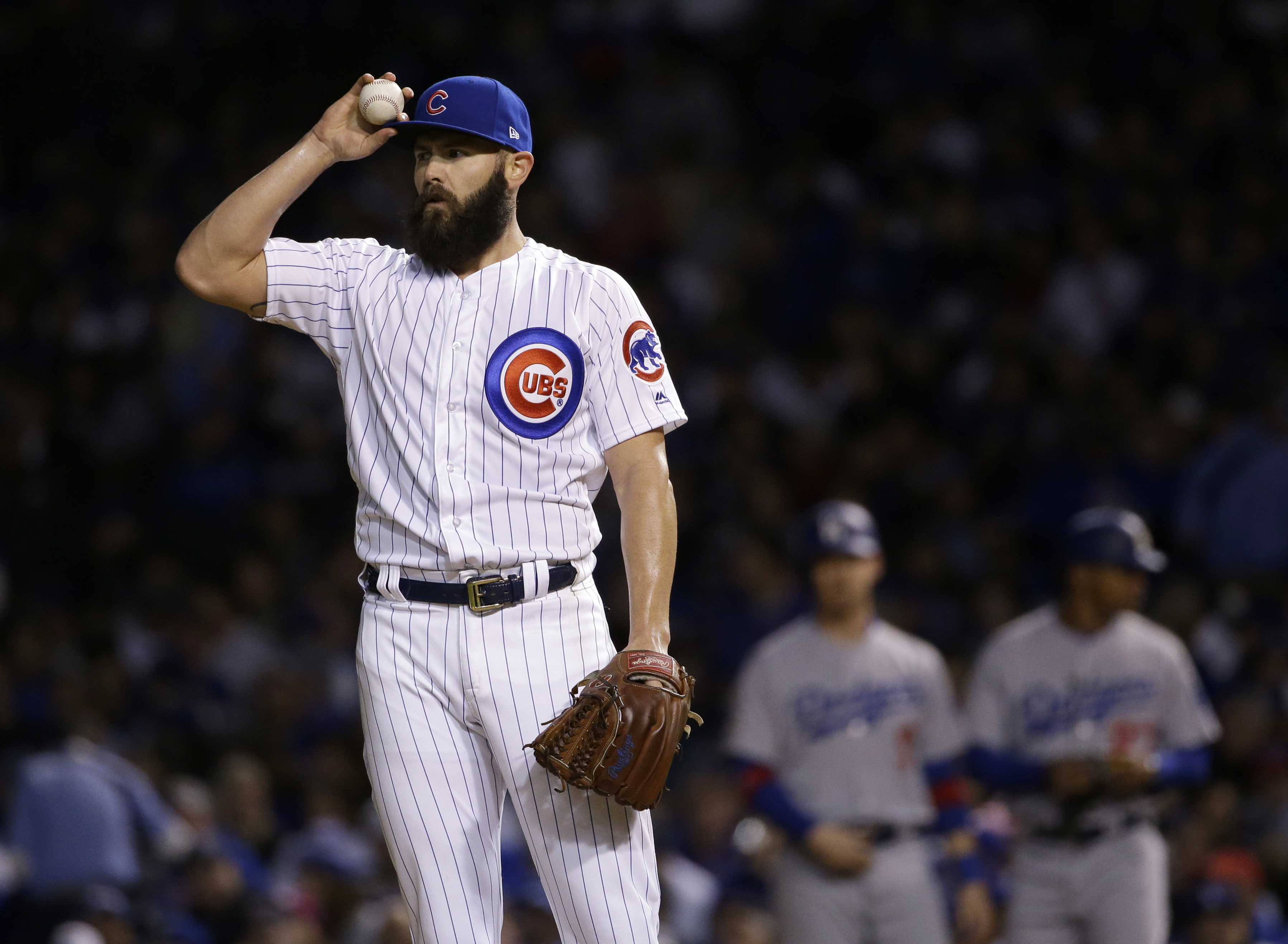 Chicago Cubs starting pitcher Jake Arrieta is the top pitching prize remaining on the free-agent market. (AP Photo/Nam Y. Huh)