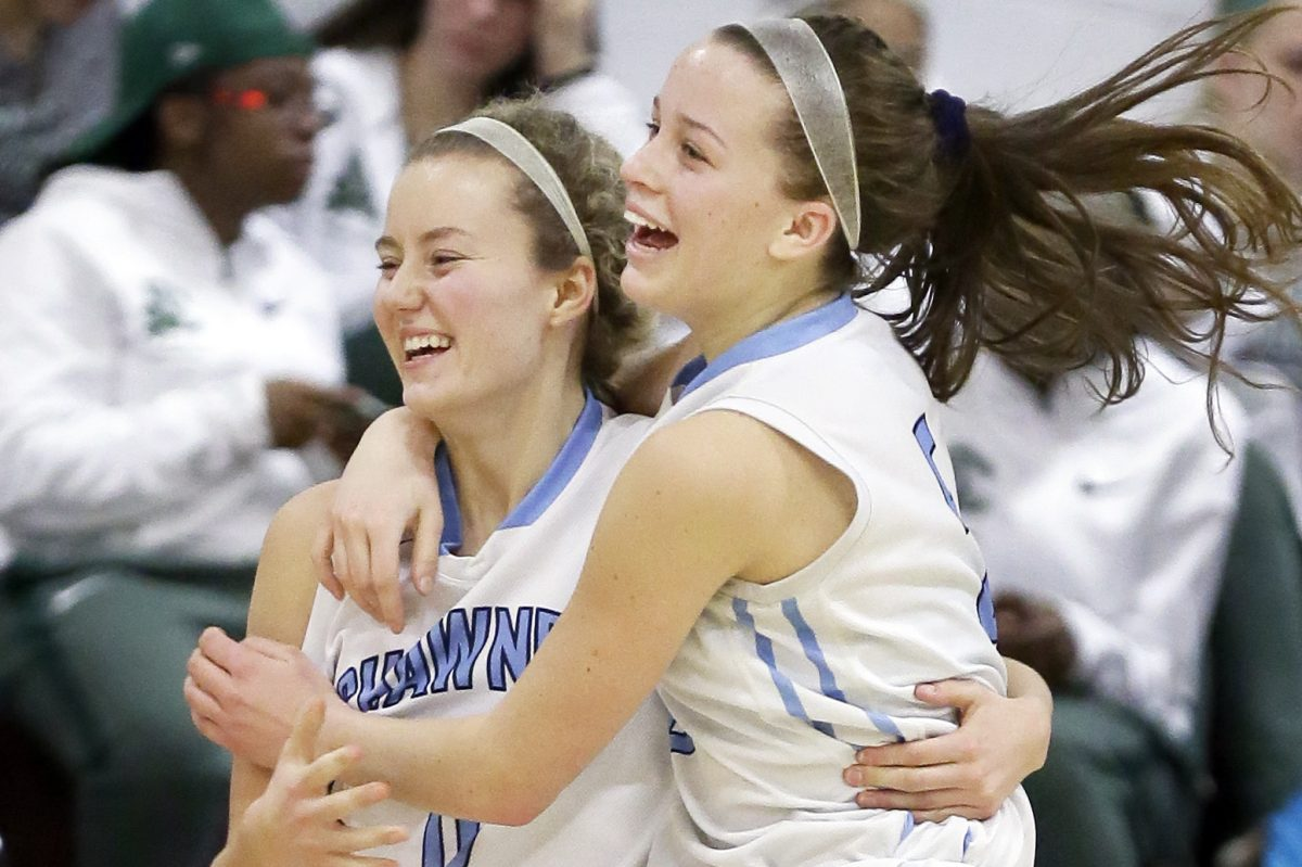 Shawnee' Erica Barr (left) and Cameron Morgan celebrate after Barr's game-winning shot.
