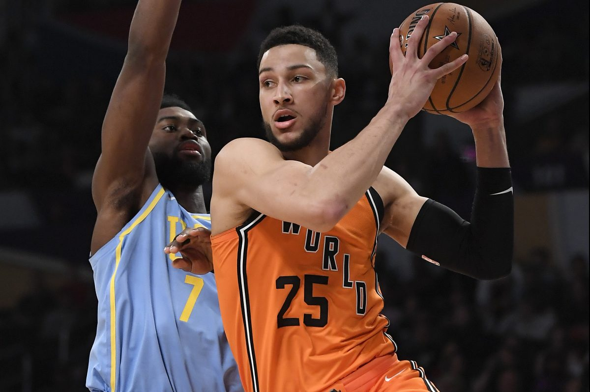 Sixers guard Ben Simmons, in the NBA Rising Stars game, moves past Celtics forward Jaylen Brown.
