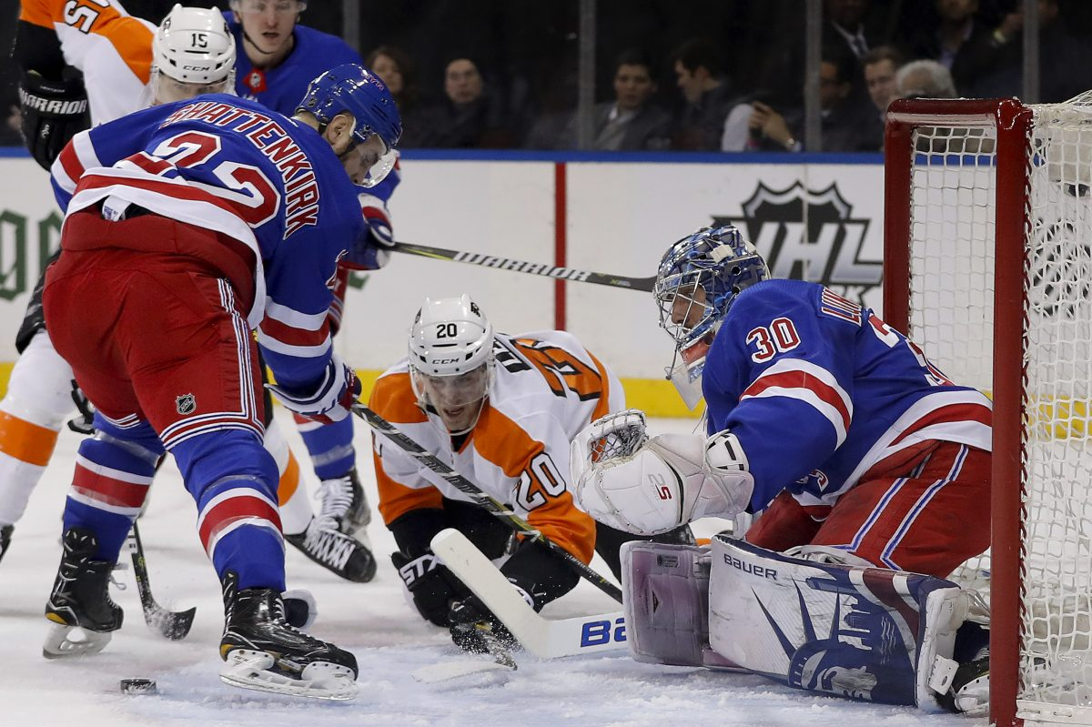 Rangers defenseman Kevin Shattenkirk (22) and Flyers winger Taylor Leier (20) look for the rebound as goaltender Henrik Lundqvist) defends the goal during New York's 5-1 win on Jan. 16.