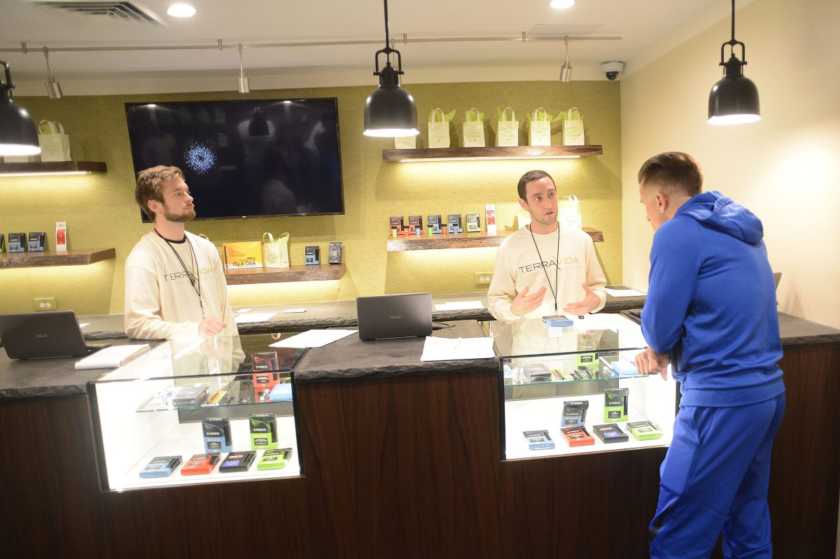 From left, Adam Prowell and Josh Reiss help patient Robert Consulmagno at TerraVida Holistic Center, which is one of the first medical marijuana dispensaries to open in Pennsylvania. (WILLIAM THOMAS CAIN / For The Inquirer)