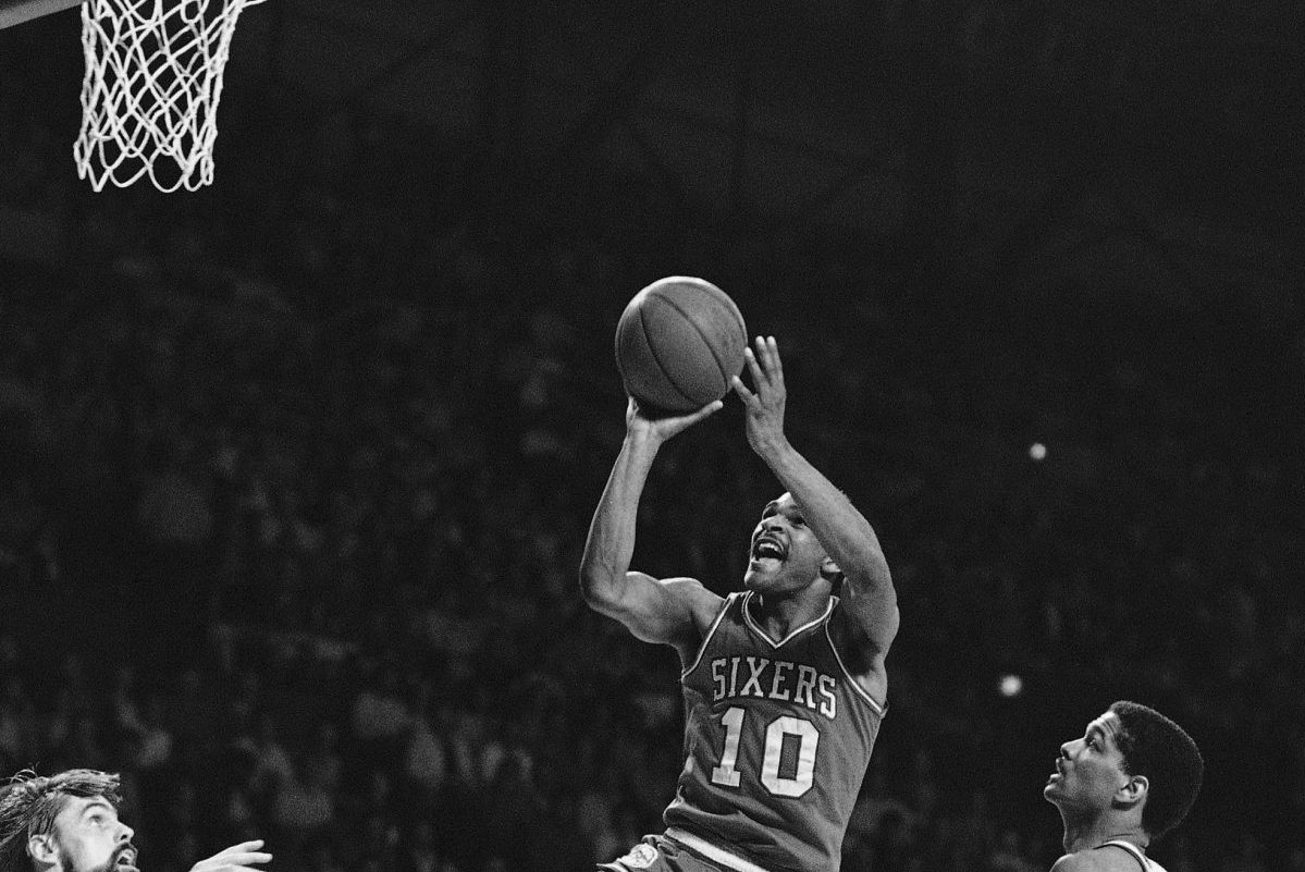 Philadelphia's Maurice Cheeks (10) puts up a shot as Milwaukee's Marques Johnson, right, watches during NBA playoff action, Friday, May 8, 1982, Milwaukee, Wisc. Cheeks lead the 76ers with 26 points as they defeated the Bucks 120-90. Philadelphia won the best of seven series four games to two and advances to meet Boston.