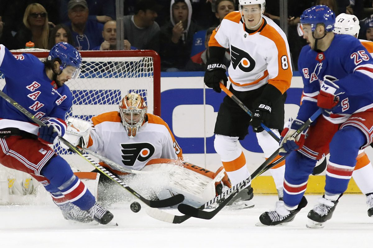 Flyers goalie Michal Neuvirth makes a save prior to being injured in Sunday's 7-4 win over the Rangers at Madison Square Garden.