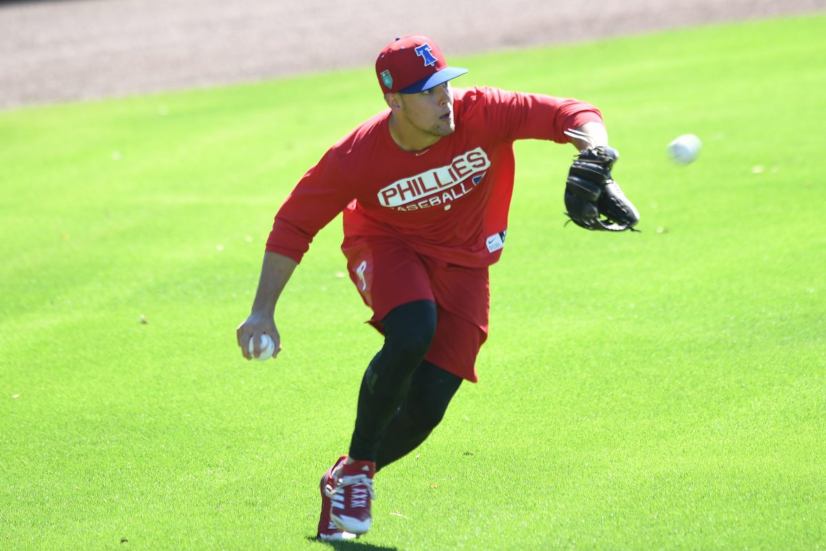 Scott Kingery fields balls during spring training workouts, where he is a non-roster invitee.