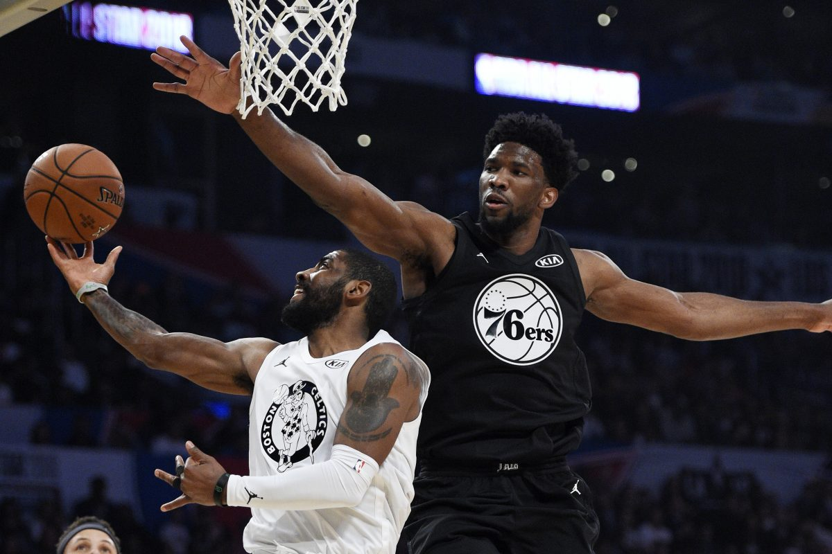 Joel Embiid goes for the block against Team LeBron player Kyrie Irving. Embiid, who was a starter for Team Stephen, had a strong first half.