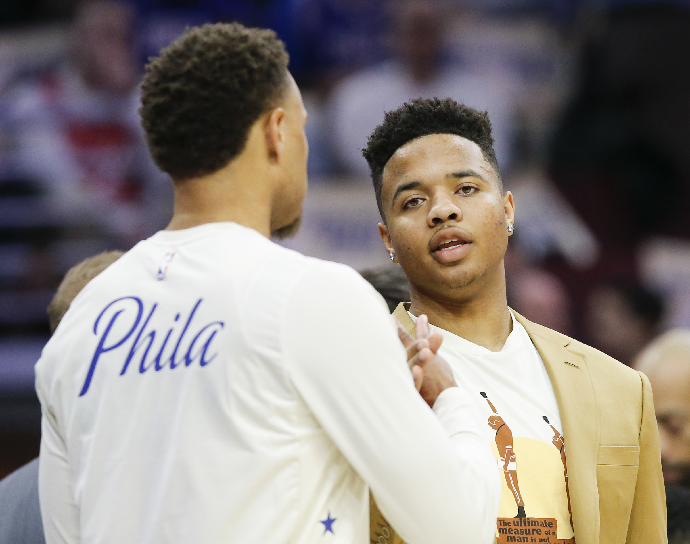 Sixers guard Markelle Fultz (right) talking to teammate Justin Anderson during a game earlier this month.