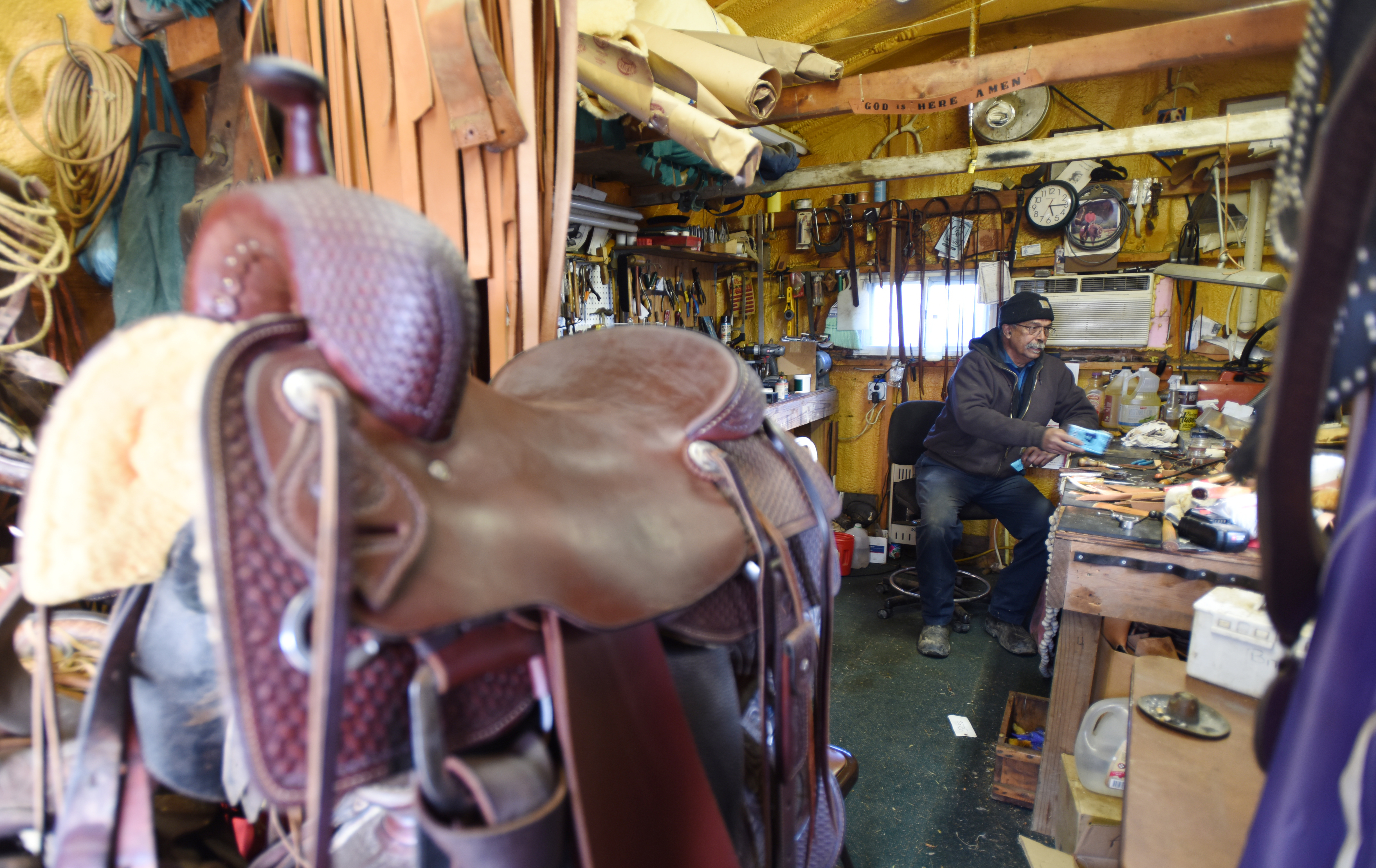 Kutztown Farmer Ray Chavous is shown working on horse saddles and reins in the leather shop at the horse barn Monday Feb. 12, 2018 in Kutztown, Pa. (Bradley C Bower/Philadelphia Inquirer)