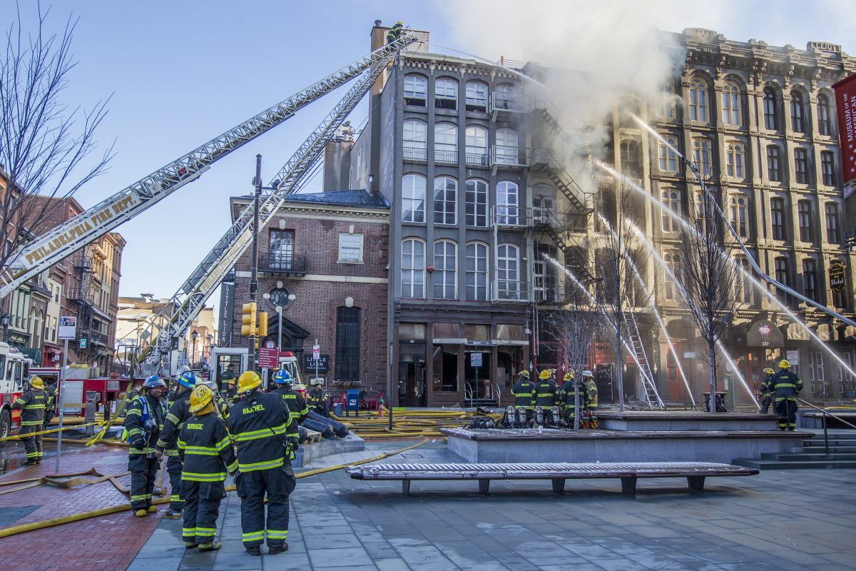 Philadelphia Firefighters use water hoses to attack the latest fire in Old City, which started in an apartment building on the 200 block of Chestnut Street,
