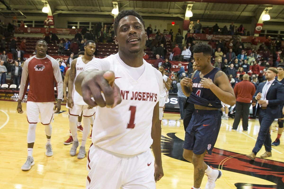 Shavar Newkirk of St. Joseph´s celebrates after their victory over Duquesne at Hagan Arena on Feb. 17, 2018. CHARLES FOX / Staff Photographer