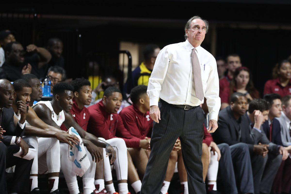 Temple coach Fran Dunphy glancing up at the scoreboard during a game against Villanova on Dec. 13.
