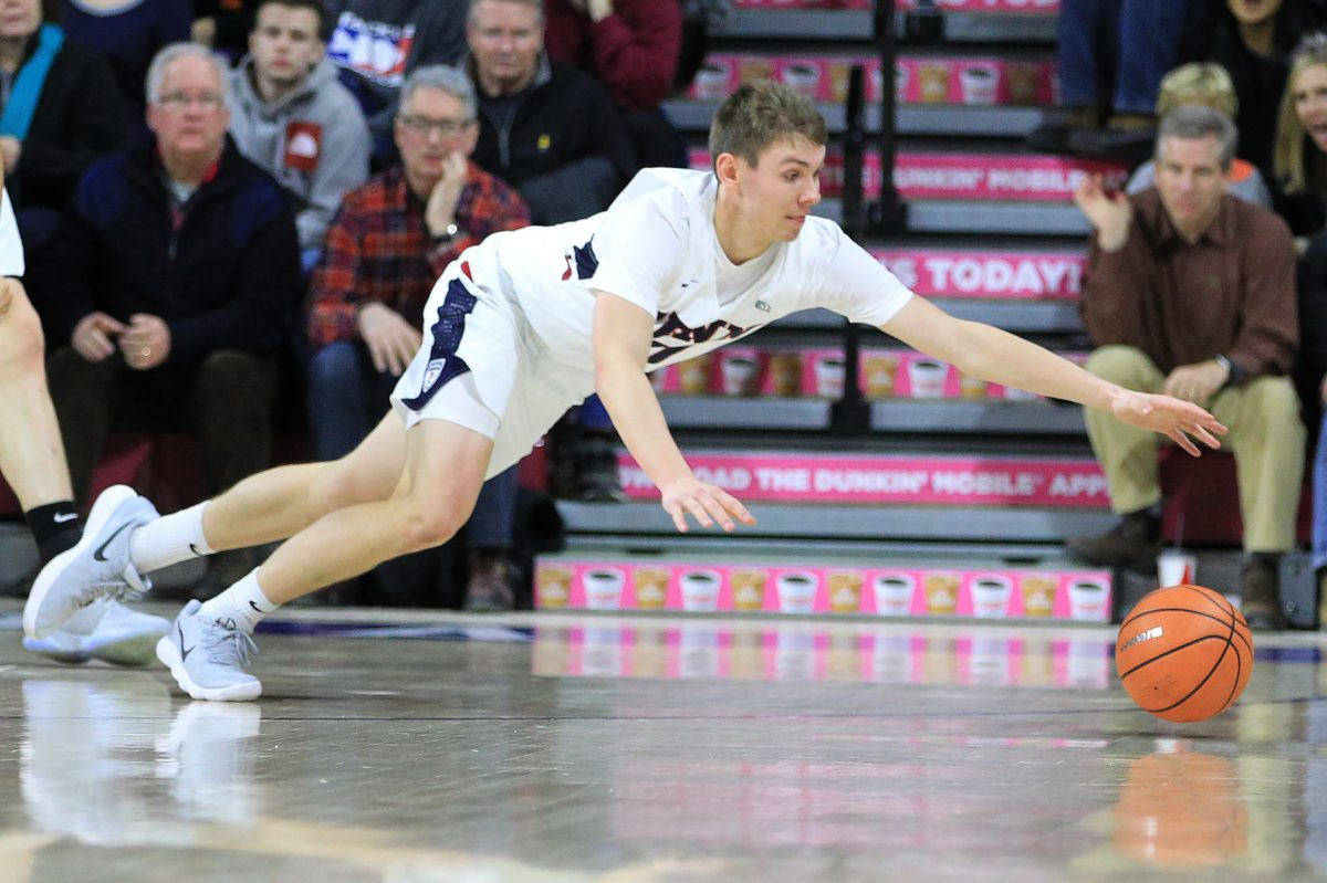 Ryan Betley of Penn diving for a loose ball against Princeton on Jan. 6.