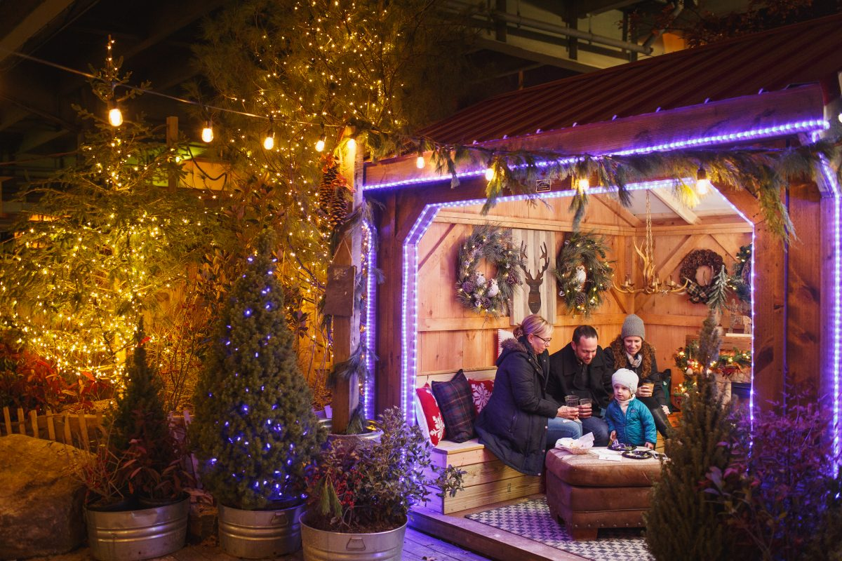 Hang out inside Blue Cross RiverRink Winterfest's warming cottages after a few laps around the Olympic-size ice rink.