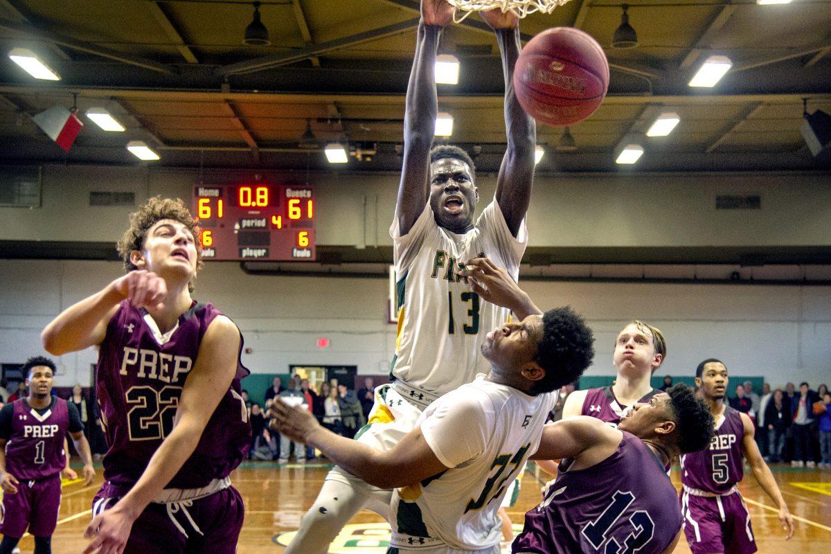 Bonner-Prendergast's Ajiri Johnson scoring the winning basket against St. Joseph's Prep on a dunk as time expires.