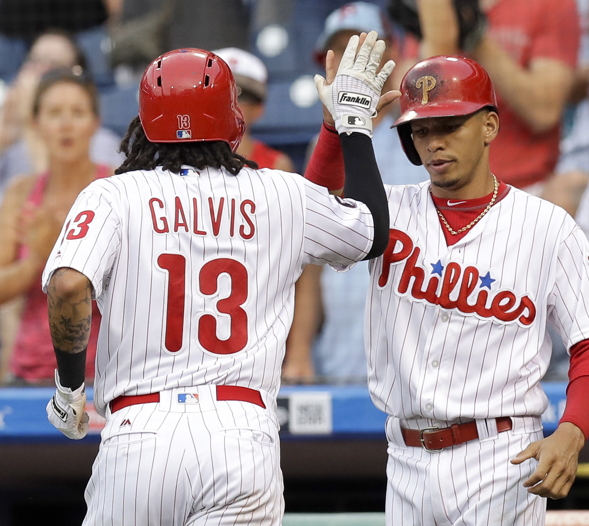 Freddy Galvis celebrates a first-inning home run with Cesar Hernandez last season against Milwaukee. Is Hernandez facing a similar fate as Galvis, who was dealt in the offseason.