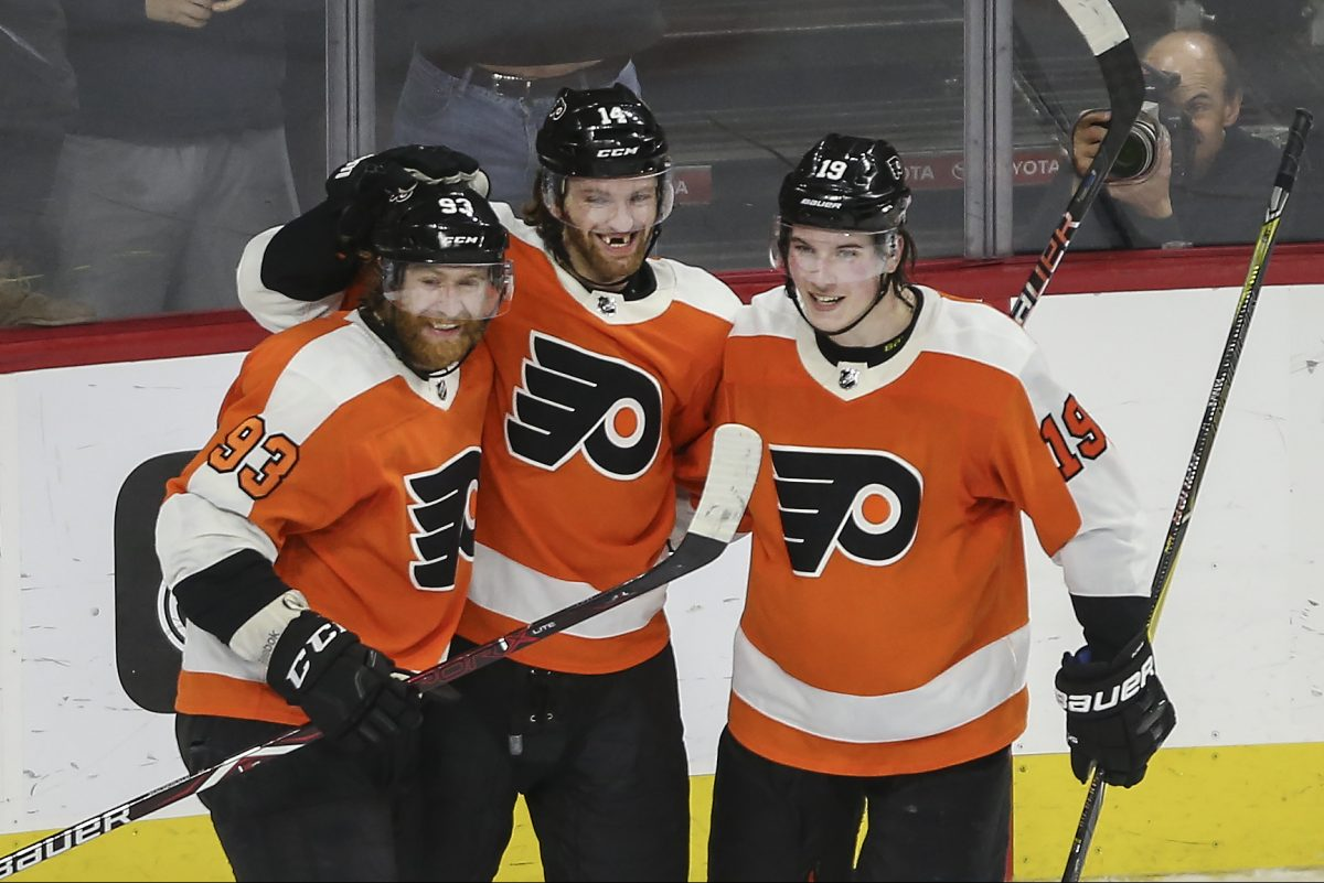 Jakub Voracek left celebrates his game-tying goal against the Canadiens with teammates Sean Couturier (14) and Nolan Patrick (19). Voracek scored in overtime to cap the Flyers' 3-2 victory.