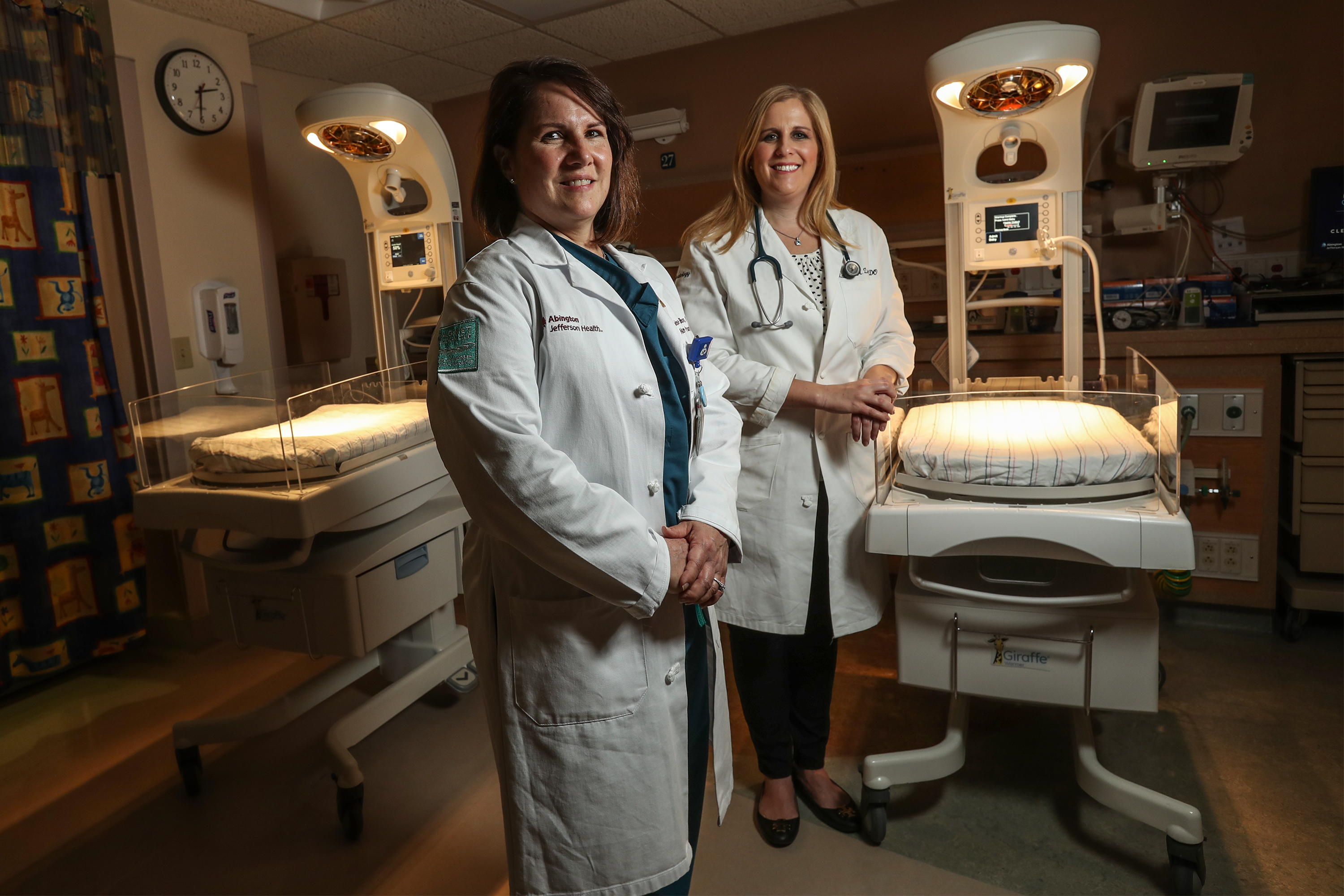 In the neonatal ICU, at Abington Hospital, nurse practitioner Denise Ellison left, and neonatologist Kathryn Ziegler watch over newborns that may have been exposed to drugs in utero.