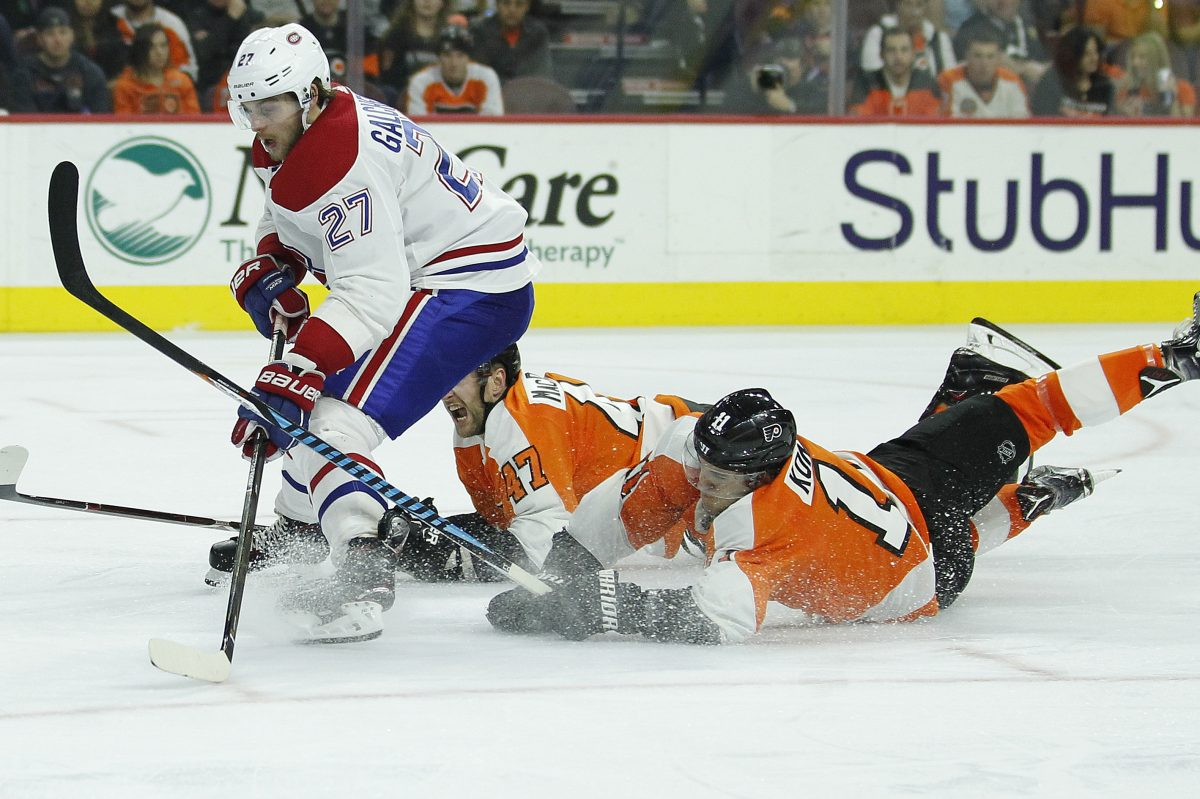 Montreal's Alex Galchenyuk getting chased on a breakaway by Andrew Macdonald (47) and Travis Konecny during the third period of the Flyers' 3-2 OT win Tuesday.