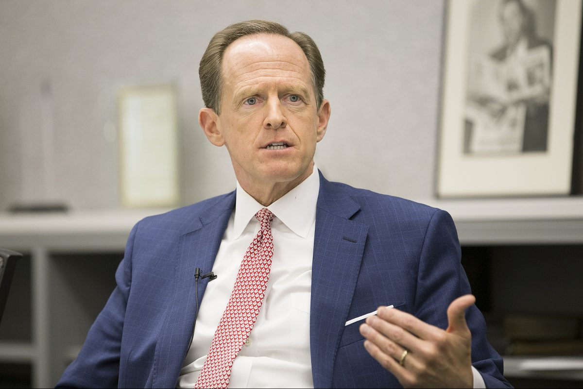 Sen. Pat Toomey (R., Pa.) speaks to editorial boards of the Philadelphia Inquirer and Daily News in 2016. He plans to reintroduce a bill to expand background checks for gun purchases.