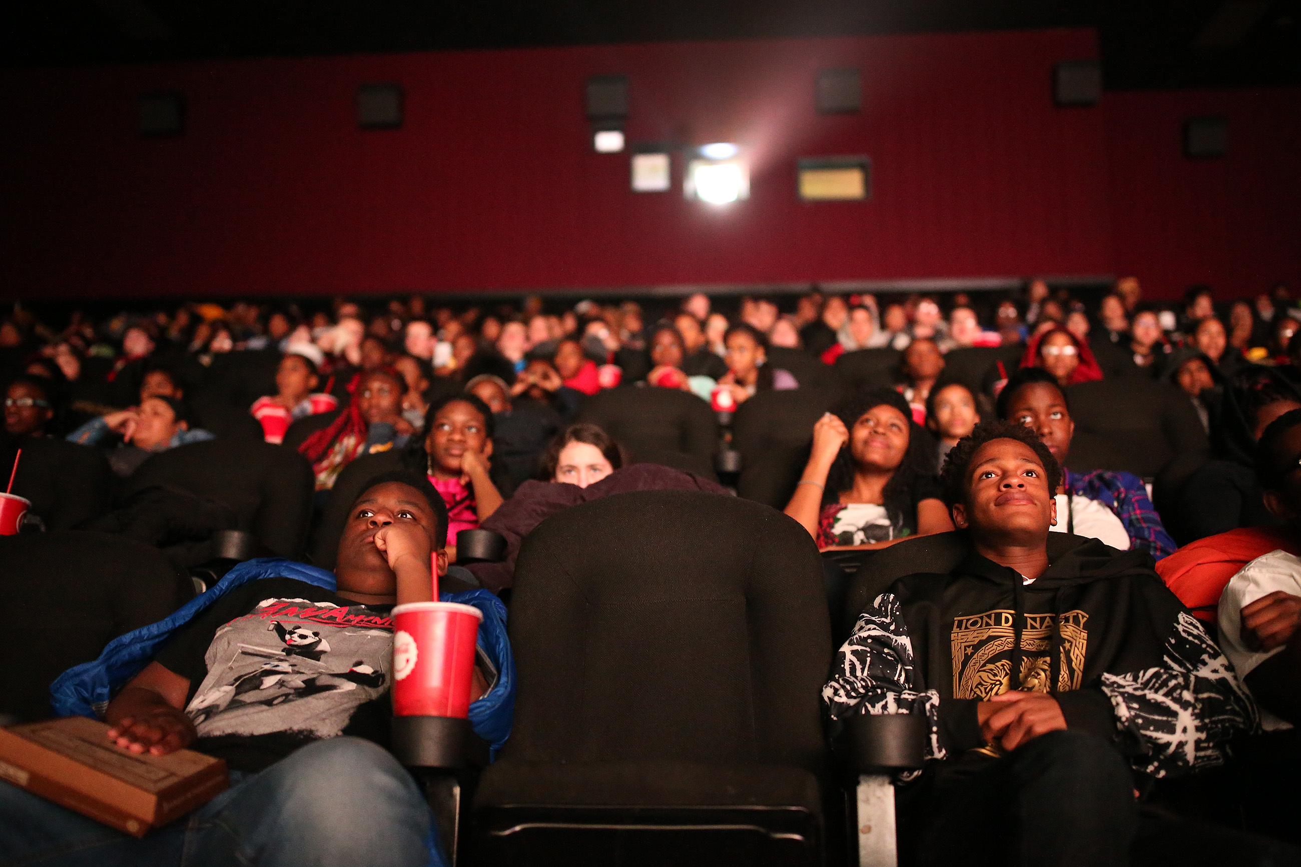 Taejon Harley, left, 14, , and Abdul Dankambany, right, 13, both of Sharon Hill School watch during the Philadelphia Media Network screening of Black Panther at the UA Riverview Plaza Stadium 17 theater in Philadelphia, PA on February 23, 2018. DAVID MAIALETTI / Staff Photographer