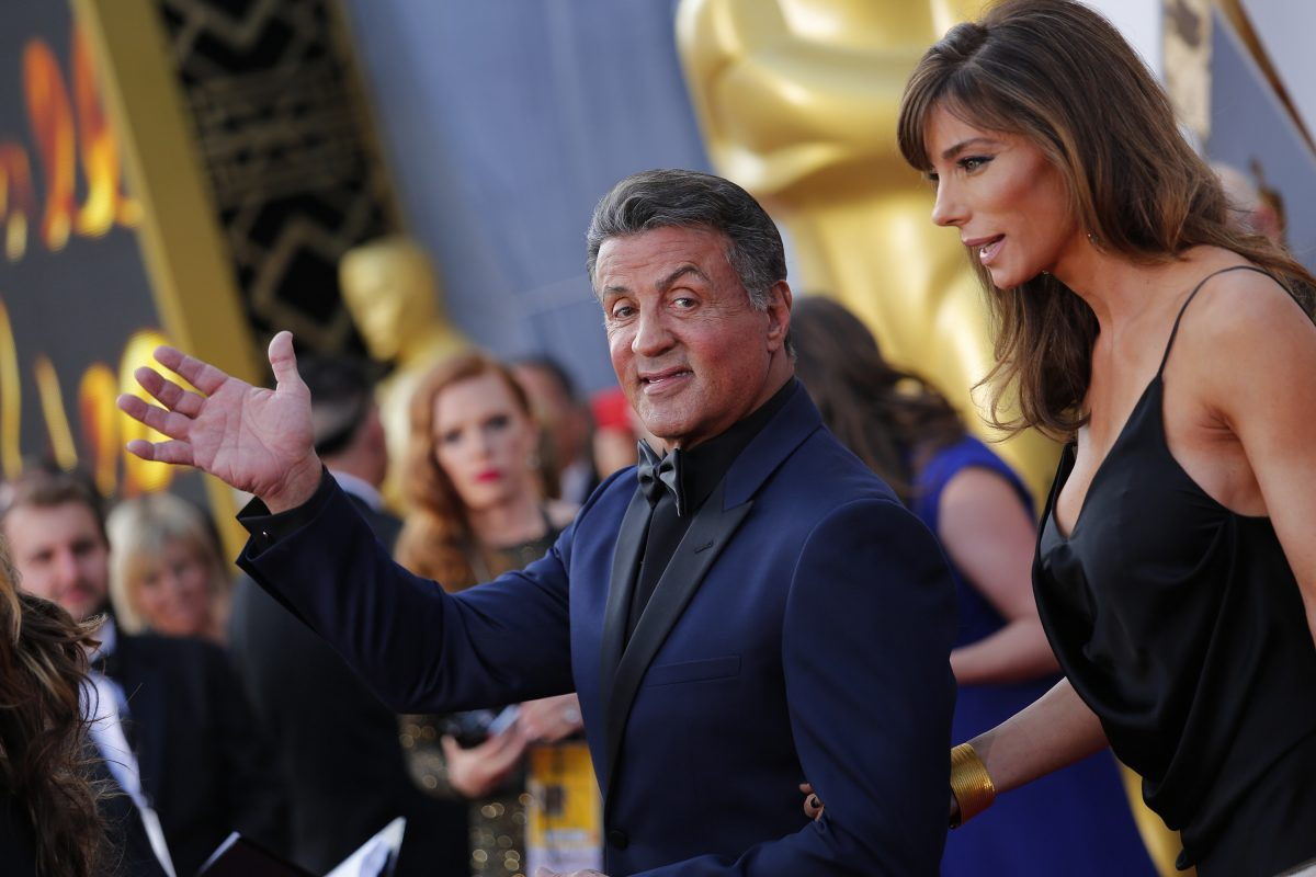 Sylvester Stallone and wife Jennifer Flavin arrive at the 88th Academy Awards on February 28, 2016, at the Dolby Theatre in Hollywood. ()