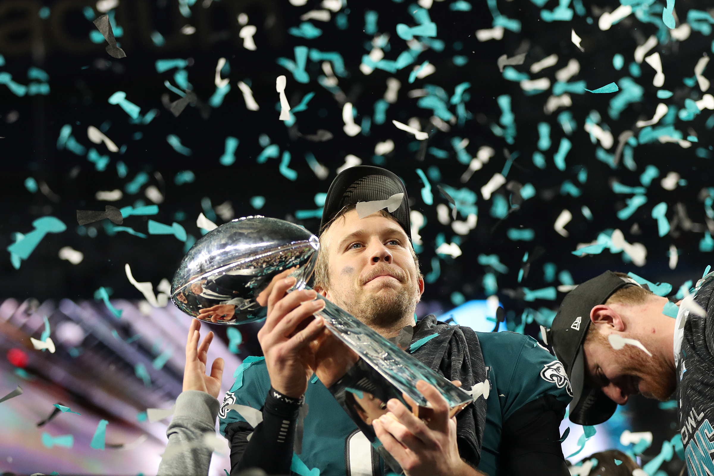 Eagles quarterback Nick Foles holds up the Lombardi trophy after Super Bowl LII, at U.S. Bank Stadium in Minneapolis, Minnesota, Sunday, Feb. 4, 2018. The Eagles won 41-33.