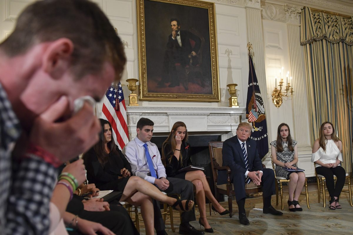 Samuel Zeif, a student at Marjory Stoneman Douglas High School, weeps after recounting his story of the shooting at his high school as other students and teachers listen, including President Trump, during an event at the White House Wednesday.