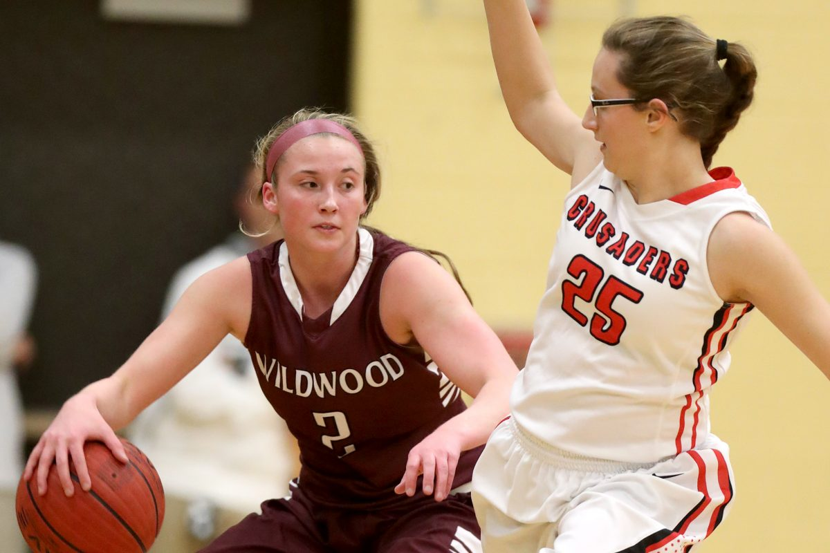 Maddie McCracken (left) of Wildwood drives up court against Jordan Todaro of Bound Brook in the 1st quarter of the Group 1 state semifinals in girls´ basketball at Deptford on March 9, 2017. CHARLES FOX / Staff Photographer