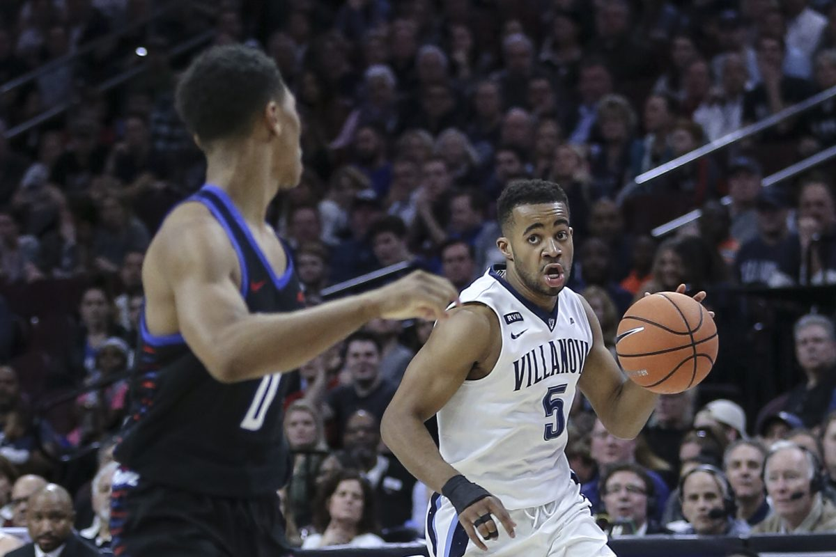 Villanova's Phil Booth drives against DePaul's Justin Roberts during the first half of the Wildcats' win on Wednesday.