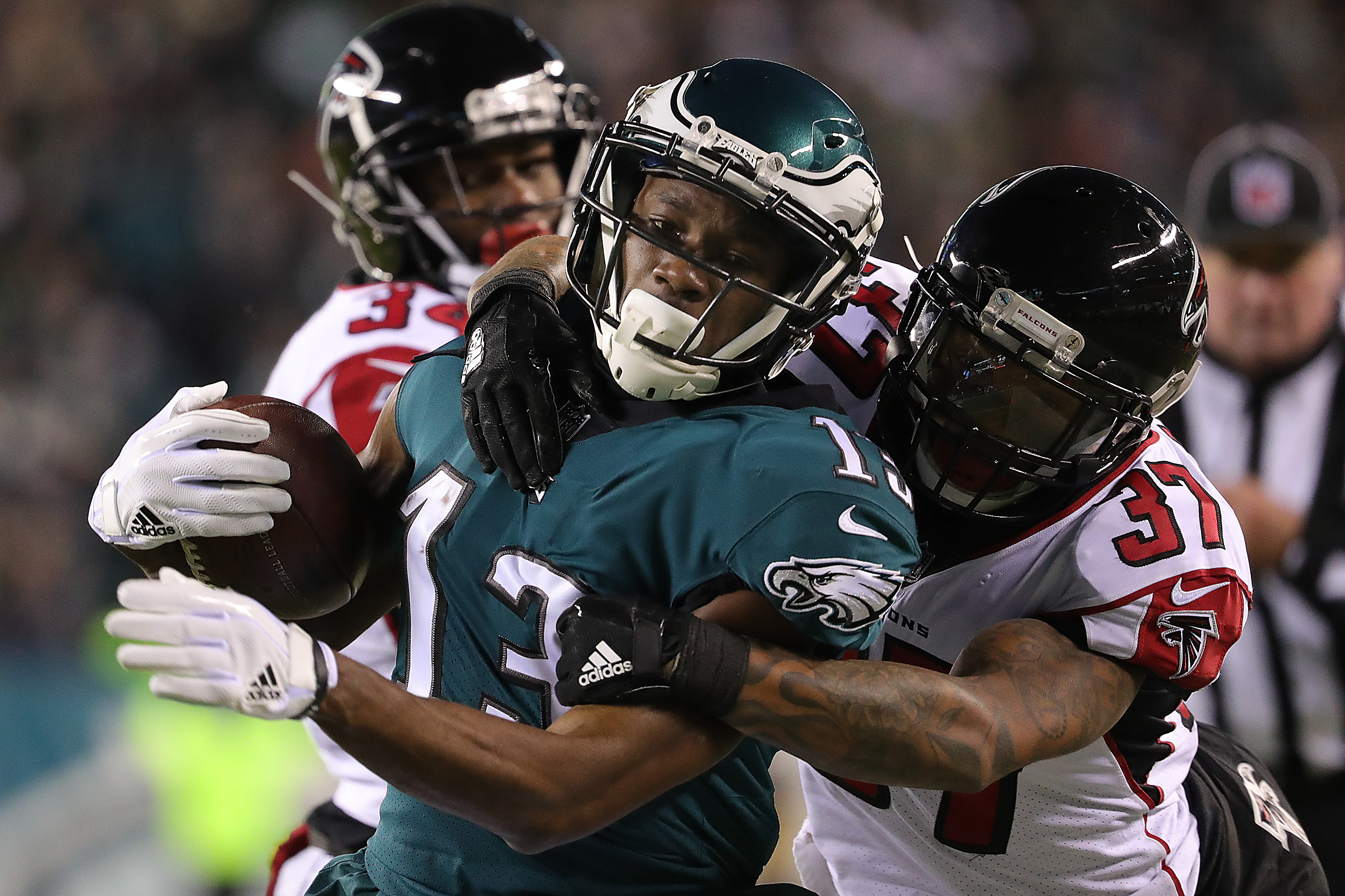 Nelson Agholor, left, is tackled after a catch against the Falcons.