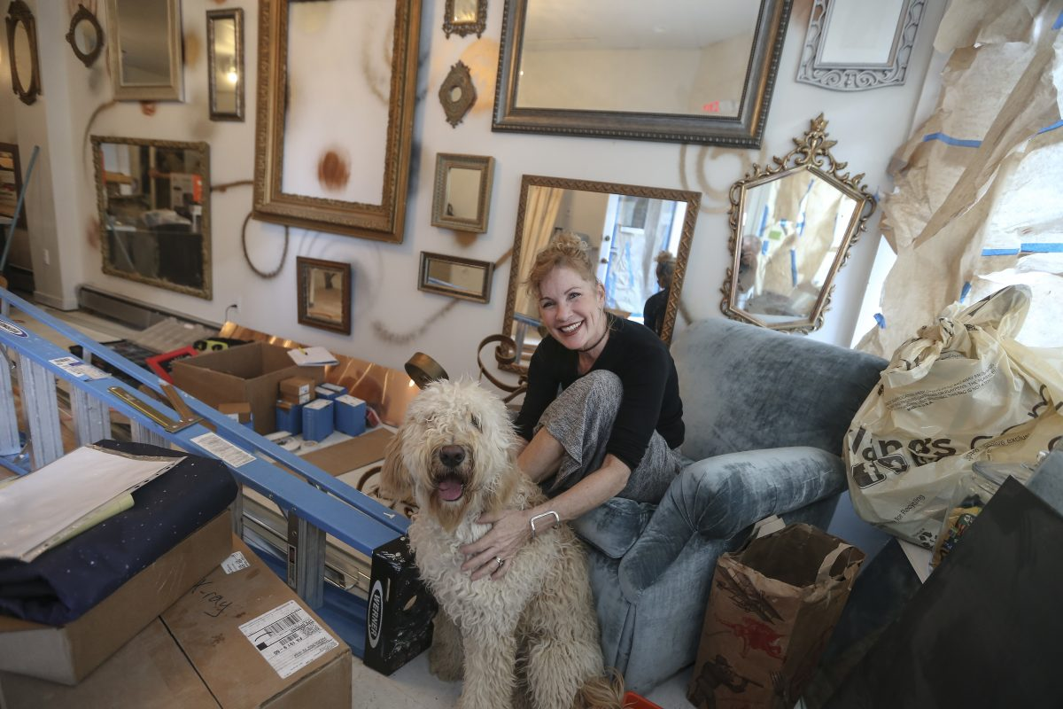 Singer-songwriter Laura Mann, disappointed with the lack of rock spaces in the city for small acts and women, decided to open her own space — the Living Room in Ardmore. Mann and her dog, Casey, in the final stages getting ready for the opening.