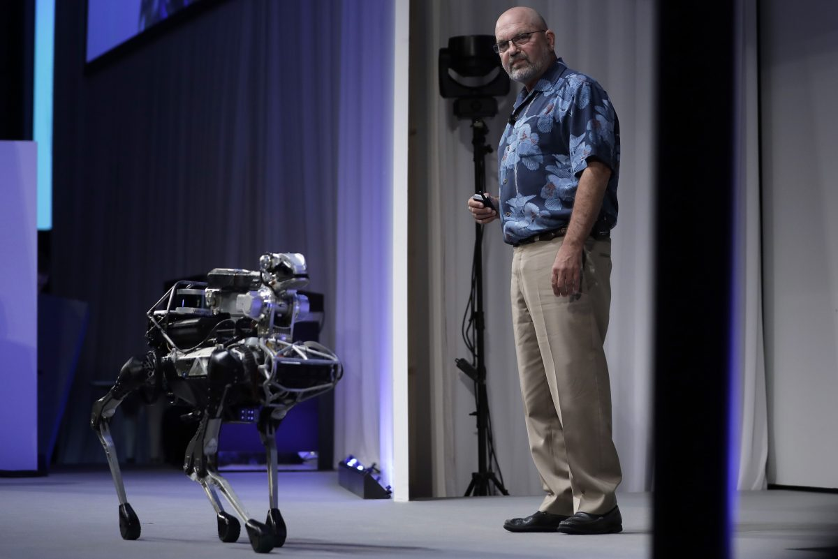 Boston Dynamics CEO Marc Raibert demostrates the company´s SpotMini robot at SoftBank World 2017 in Tokyo on July 20, 2017.