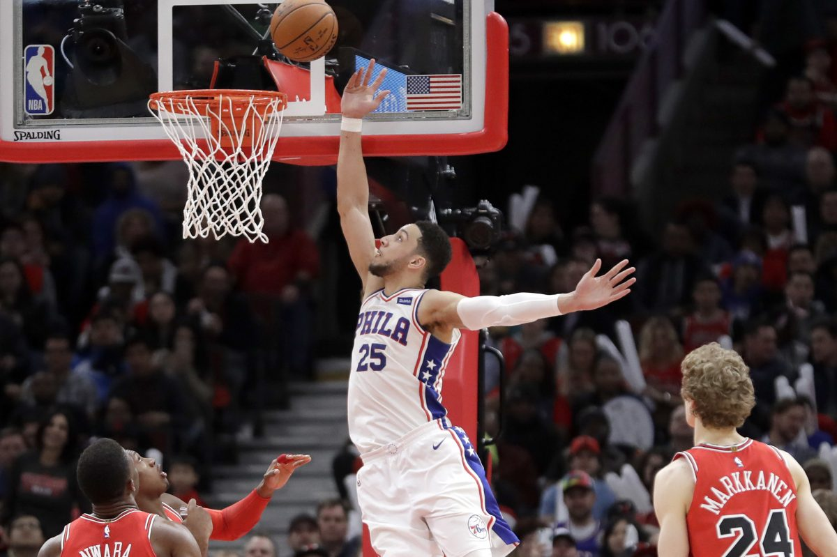 Sixers guard Ben Simmons rises up for a tip-in off a pass from Joel Embiid in the team's 116-115 win over the Bulls on Thursday.