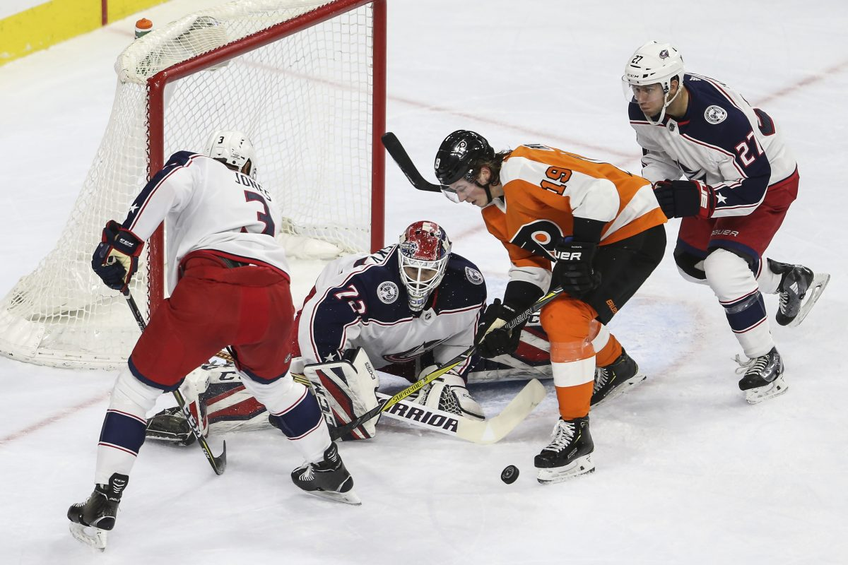 Flyers' rookie Nolan Patrick tries to get the puck past Blue Jackets' goalie and former Flyer Sergei Bobrovsky in the team's 2-1 win.