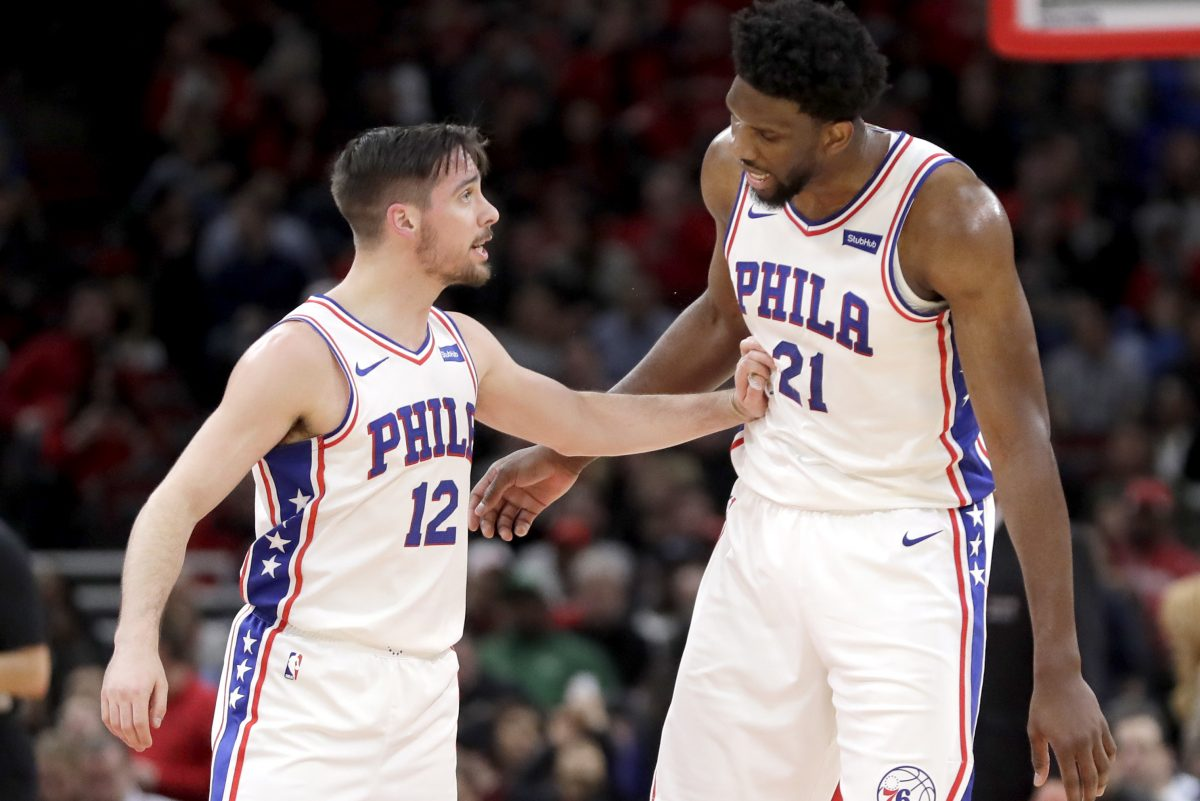 Sixers guard T.J. McConnell and Joel Embiid during the first half of the Sixers' win over the Bulls on Thursday.