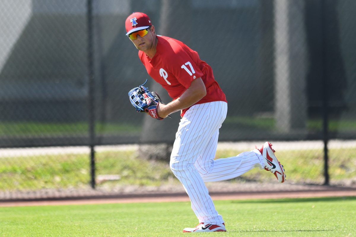 Rhys Hoskins chases down a ball in the outfield during spring training workouts.
