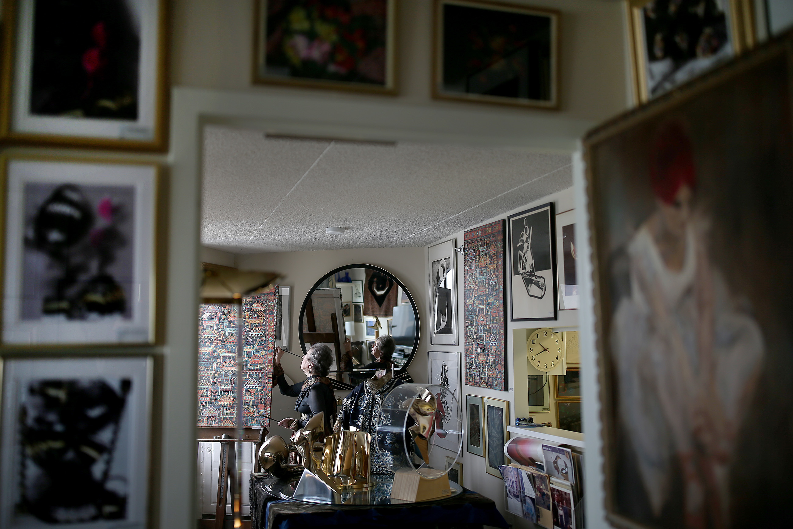 Myrna Bloom works inside her art gallery/apartment.