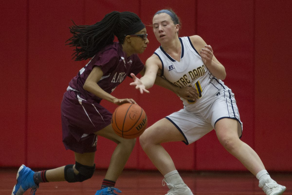 Academy of Notre Dame, Mandy McGurk, right, 11, attempts to steal the ball from Abington High School, Jordyn Allen, 1, during the 2nd quarter of the game in the 2017 December Classic Tournament at Germantown Academy High School. Abington won the game 73-57.