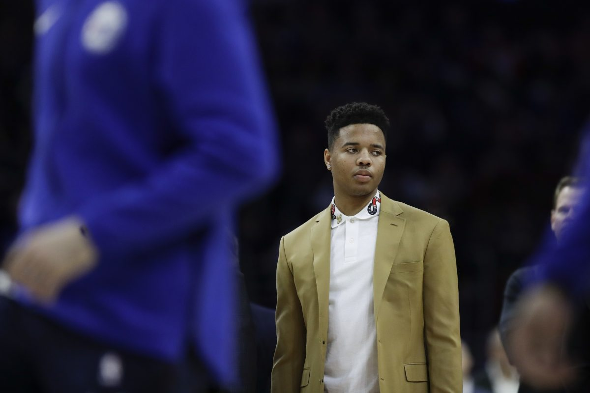Sixers guard Markelle Fultz watches pregame warm-ups before the Sixers play Milwaukee Bucks on Saturday, January 20, 2018 in Philadelphia.