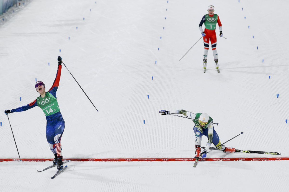 Jessica Diggins, left, of the United States, celebrates after winning the gold medal past Stina Nilsson, of Sweden, in the during women´s team sprint freestyle cross-country skiing final at the 2018 Winter Olympics in Pyeongchang, South Korea, Wednesday, Feb. 21, 2018.